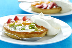 Fruit Tarts with Whipped Cream Stock Images