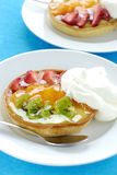 Assorted Fruit Tarts with Whipped Cream Stock Photos