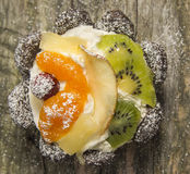 Fruit tart with apple and chocolate on old wood Royalty Free Stock Photos