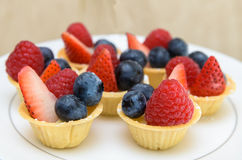 Fruit Tart with berries on disc Royalty Free Stock Photos