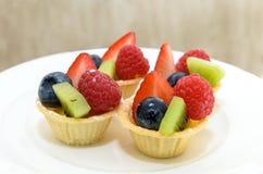 Fruit Tart with berries and kiwi Stock Photo