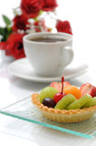 Fruit tart and coffee. Coffee cup, fruit tart and rose Stock Photos