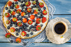 Fruit tart and coffee in the garden Stock Photo