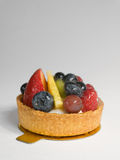 Fruit Tart Dessert. With Strawberries, Blueberries, Pineapple, and Kiwi royalty free stock image