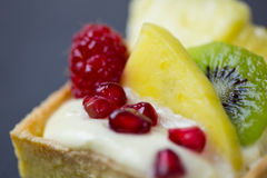 Fruit tart dessert on dark background. Closeup shot of fresh tart dessert stock photos