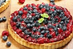 Fruit tart dessert with raspberries blackberries and cranberries Royalty Free Stock Photography