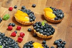 Fruit tart dessert with raspberries blackberries and cranberries Royalty Free Stock Photo