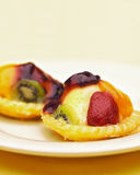 Fruit tart flan. With many different fruits on it and custard Stock Photos