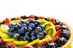 Fruit tart. Fresh fruit tart made in large round form on a white background royalty free stock photography