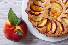 Fruit tart and fresh peach closeup top view Royalty Free Stock Photo
