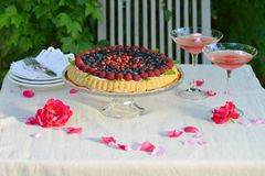Fruit tart with fresh raspberry and blueberry. With a cocktails Stock Photography