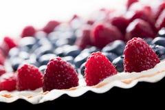 Fruit tart with fresh raspberry and blueberry. Morning light Stock Image
