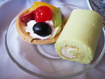 Fruit tart and Jam roll on plate Royalty Free Stock Photo