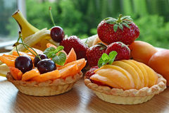 Fruit tart, mini baskets filled with fresh fruits Royalty Free Stock Photography