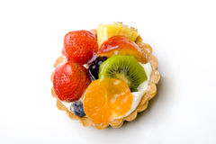 Fruit tart pastry delicious dessert. Strawberry, kiwi, tangerine, pineapple delicious dessert fruit tart pastry with whipped cream layer royalty free stock photo