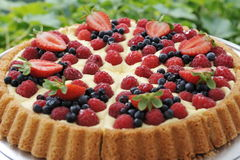 Fruit tart pie. With fresh raspberry and blueberry stock images
