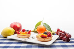 Fruit tart on plate. On an plate of delicious fruit tart Royalty Free Stock Photo