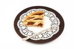 Fruit tart slice. Apricot jam tart slide with fork Royalty Free Stock Image