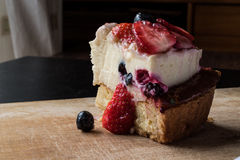 Fruit Tart Slice with strawberry and berries. Royalty Free Stock Images