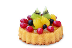 Fruit tart sponge cake on white. Sponge cake flan filled with forest fruits, kiwi and custard isolated on white background stock photo