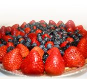 Fruit tart with strawberries and blueberries Royalty Free Stock Images