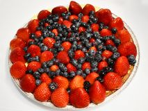 Fruit tart with strawberries and blueberries stock images