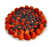 Fruit tart with strawberries and blueberries stock image