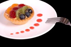 Fruit tart with strawberry sauce. Fruit tart on white plate with strawberry sauce Stock Photography