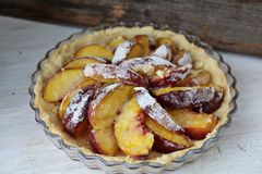 Fruit tart. Summer tart with sliced peaches Stock Photography