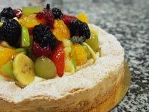Mixed fruit tart, marble surface Royalty Free Stock Photo