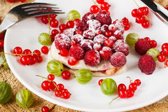 Fruit tart on white plate, viewed from above. Decorated of fresh berries stock photos