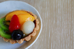 Fruit tart. On wooden background Stock Photography