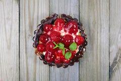 Fruit tart on wooden background Royalty Free Stock Image