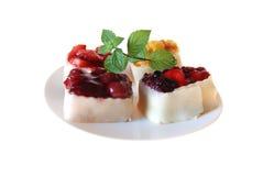 Fruit tartlets. 4 fruit tartlets on a plate stock images