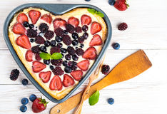 Fruit tarts with berries. Fruit pudding with berries and fresh mint Stock Photos