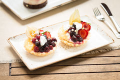 Fruit tarts on a wooden background Royalty Free Stock Image