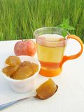 Fruit tea with apple jam Royalty Free Stock Images