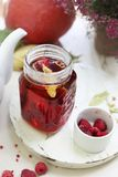 Tea with raspberries. Fruit tea. Aromatic hot tea with raspberries stock photo