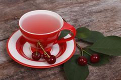 Fruit tea with cherry berries on old wooden Royalty Free Stock Photo