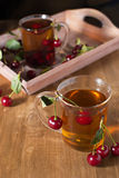 Fruit tea with cherry. Summer fruit tea with cherry Stock Image