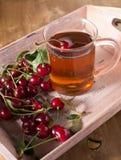 Fruit tea with cherry Stock Photos