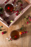 Fruit tea with cherry. Summer fruit tea with cherry Royalty Free Stock Photos