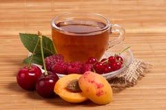 Fruit tea in cup Stock Image