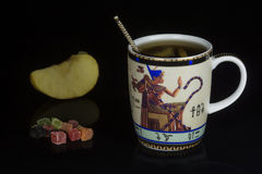 Fruit tea. Cup candied fruit and a slice of apple Low key Stock Photography