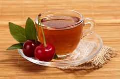 Fruit tea in cup with cherry Stock Photography