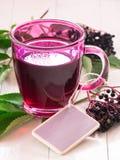 Fruit tea with elderberry Stock Photo