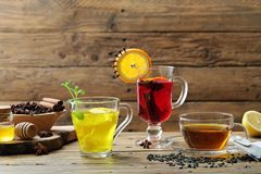 Fruit tea with ginger lemon and herbs in glass cup on rustic background. Fruit tea with ginger lemon and herbs in glass cup stock photos