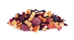 Fruit tea with hibiscus, apple, raspberry, rose petals and dog-rose, isolated on white background. Fruit tea with hibiscus, apple, raspberry, rose petals and royalty free stock images