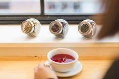 Fruit tea and jars of herbs