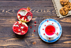 Fruit tea with lemon, milk, honey, orange, pomegranate, on a woode. Fruit tea with, lemon, milk, honey, orange, pomegranate and brown sugar, on a wooden stock photography